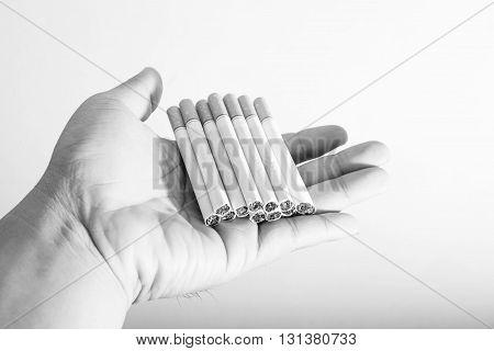 Black And White Man Hand Hold Cigarette. World No Tobacco Day