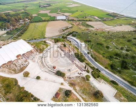 Aerial view of the arcaeological site of the ancient city of Kourio which is located in the district of Limassol Cyprus. A view from the top of the greek roman theatre forming a semicircle the beach and fields.