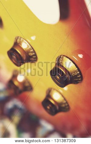 macro detail of an electric guitar knobs