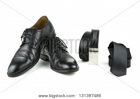 over-white portrait of black accessories for man