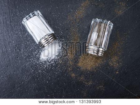 Salt And Pepper Shakers On A Slate Slab