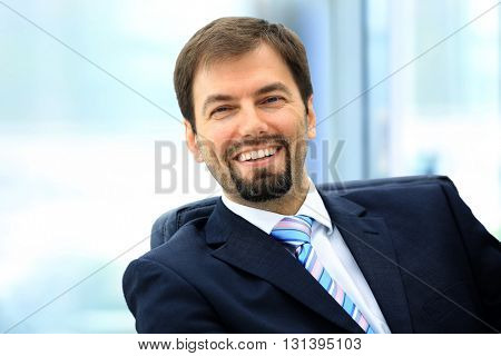 Happy mature business man looking at camera