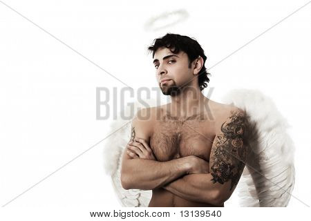 Handsome male angel. Shot in a studio.