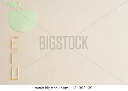 Eco Concept. Abstract green apple and eco word of wooden sticks.The word ECO made of wooden sticks on a beige background with copy space.
