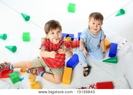 Beautiful children enjoying their game. Shot in a studio.