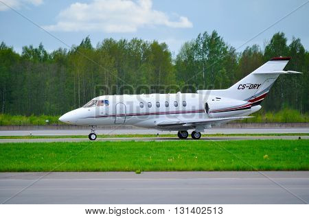 SAINT-PETERSBURGRUSSIA -MAY 232015. NetJets Europe Airlines Hawker Beechcraft Hawker 800XP business jet-registration number CS-DRY- rides on the runway after arrival at Pulkovo International Airport