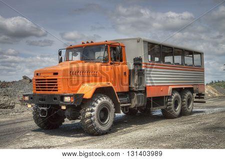 Poltava Region Ukraine - June 26 2010: Mining crew bus driving along the opencast road