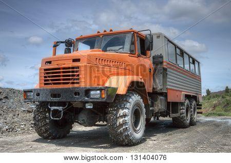 Poltava Region Ukraine - June 26 2010: Mining crew bus on the opencast road
