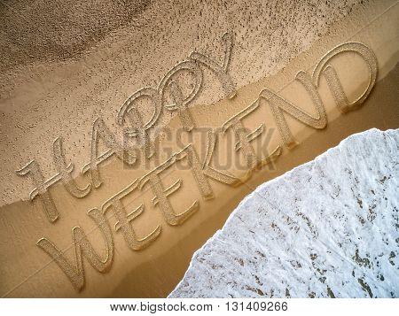 Happy Weekend written on the beach