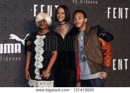NEW YORK-FEB 12: (L-R) Monica Braithwaite, Rihanna and Rajad Fenty attend the FENTY PUMA by Rihanna AW16 Collection during Fall 2016 New York Fashion Week on February 12, 2016 in New York City.