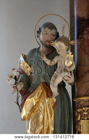 PRIMISWEILER, GERMANY - OCTOBER 20: Saint Joseph holding baby Jesus, church of St. Clement in Primisweiler, Germany on October 20, 2014.