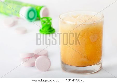 Effervescent vitamin tablets in glass of water
