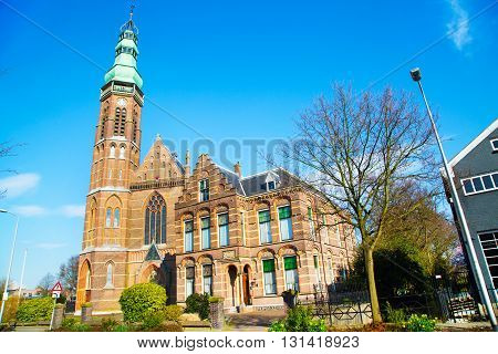 St. Agatha church in Lisse, the Netherlands against blue sky