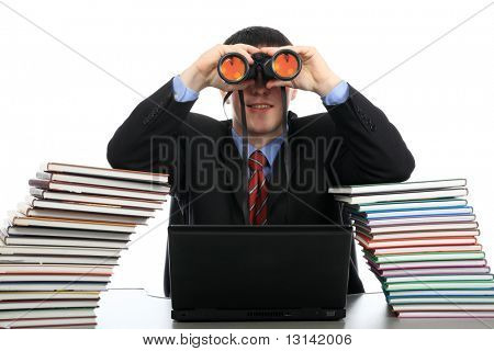Portrait of a young man looking through a binocular. Theme: education career, success.