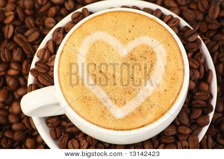 Coffee background: Close-up of a beans, cup, mill