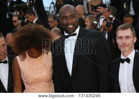 CANNES, FRANCE - MAY 21: Teddy Riner and his partner Luthna Lors attend the 'Elle' Premiere during the 69th annual Cannes Film Festival at the Palais des Festivals on May 21, 2016 in Cannes, France.