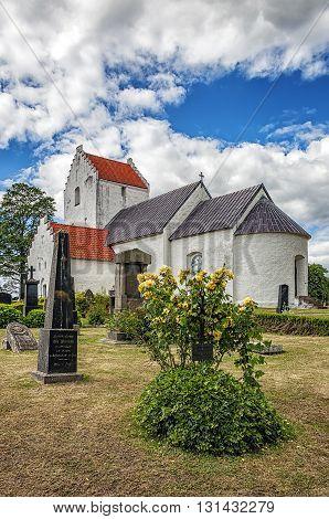 An image of the old white Ravlunda church in the swedish region of Skane.