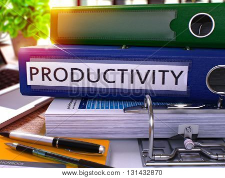 Blue Office Folder with Inscription Productivity on Office Desktop with Office Supplies and Modern Laptop. Productivity Business Concept on Blurred Background. Productivity - Toned Image. 3D.
