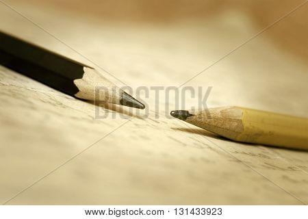 Vintage background - old pencils lying on a letter