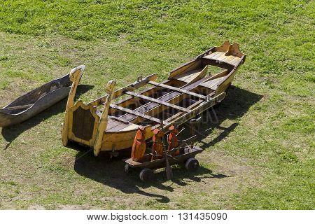 KIRILLOV RUSSIA - MAY 28 2013: Kirillo-Belozersky Monastery. Museum artifacts of antiquity - Russian wooden fishing canoes monastery.