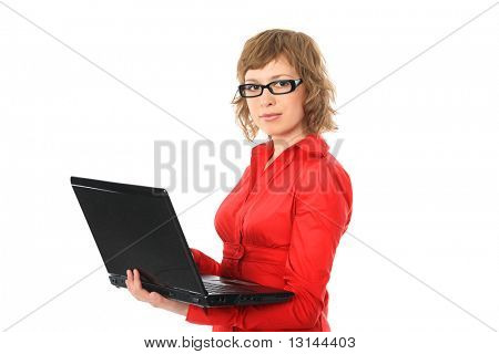 Portrait of a pretty young woman with a laptop. Shot in studio.