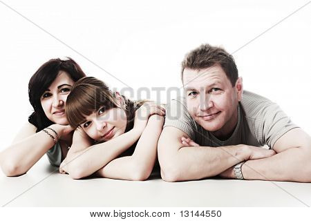 Happy family: parents with their grown-up daughter.