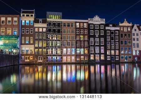 Beautiful Traditional Old Buildings On Canal In Amsterdam At Night