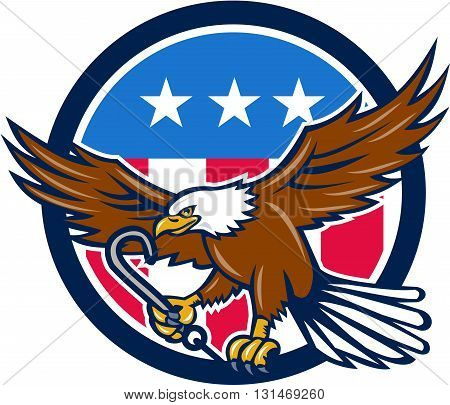 Illustration of an american bald eagle clutching towing j hook with its talon viewed from side set inside circle with usa stars and stripes flag in the background done in retro style.