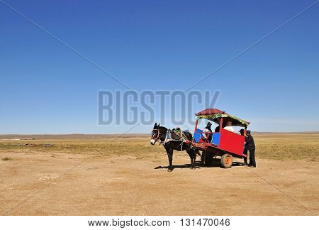 BAOTOU CHINA - OCTOBER 2, 2012: A horse and carriage available for rent in Xilamuren Grassland in Baotou City. Xilamuren Grassland is one of the must-see attractions in Inner Mongolia.