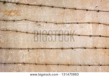 Concrete wall with barbed wire, Phnom Penh, Cambodia