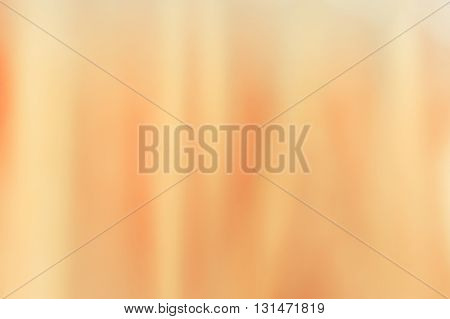 Abstract soft peachy background. Texture of silk peachy cloth folded. Abstract pastel motion background.