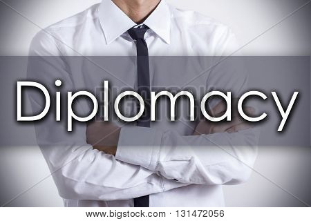 Diplomacy - Young Businessman With Text - Business Concept