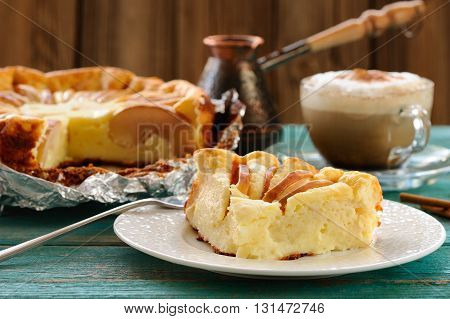 Syrnik quark pie with apples served with Vienna coffee on old wooden table horizontal
