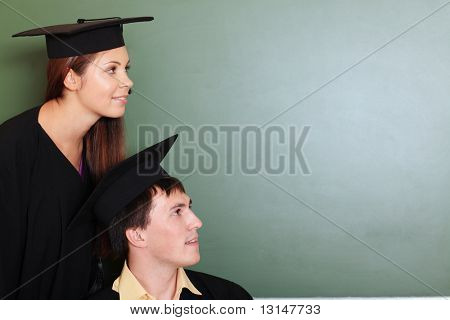 Educational theme: graduating students in academic gown in a classroom.