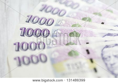 business finance saving and cash concept - close up of czech paper money and coins on table