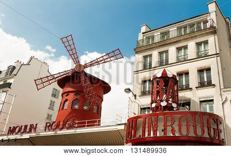 Paris France-May 25 2016 : The famous cabaret Moulin Rouge located close to Montmartre in the Paris ditrict of Pigalle on boulevard Clichy .