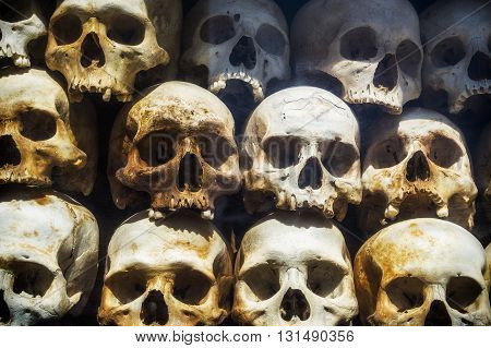 Human skulls of victims of the Khmer Rouge stacked at the Killing Fields of Choeung Ek in Phnom Penh, Cambodia.