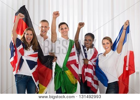 Patriotic Group Of Happy People Cheering With Flags From Different Nations