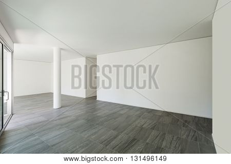 Interior of empty apartment, wide room with white walls
