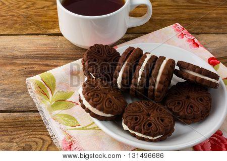 Homemade chocolate sandwiches top view. Chocolate cookies. Homemade biscuit. Breakfast cookies.Cookies sandwiches. Chocolate sandwiches. Sweet dessert.