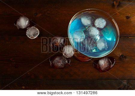 Iced blue cosmopolitan cocktail. Blue margarita. Blue cosmopolitan. Blue Lagoon. Blue cocktail. Blue Martini. Blue Hawaiian cocktail. Blue curacao liqueur.
