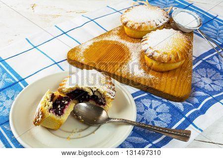 Jam dessert pie on the white plate. Sweet dessert. Sweet pastry. Pie. Jam pie Small pie.