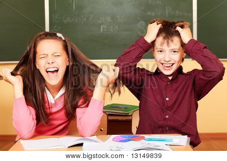 Educational theme: funny schoolchildren in a classroom.