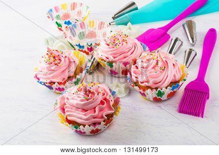 Pink cupcakes and kitchen utensils. Birthday cupcakes. Homemade cupcake. Sweet dessert. Sweet pastry. Gourmet cupcakes. Sweet cupcake.