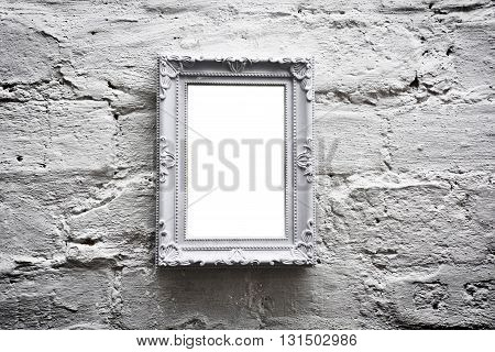 White empty frame with free copy space on white grunge brick wall. Grunge picture.