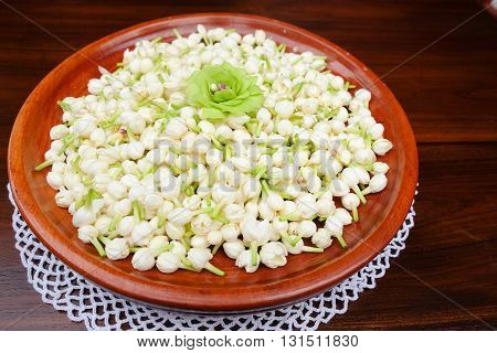 Group of white budded jasmine for making festoon