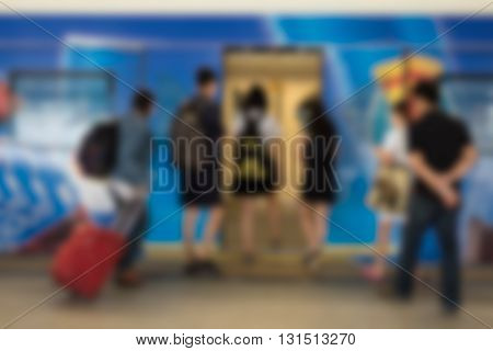 Abstract blurry image of BTS Station in Bangkok Thailand. People waiting standing and walking on BTS sky train