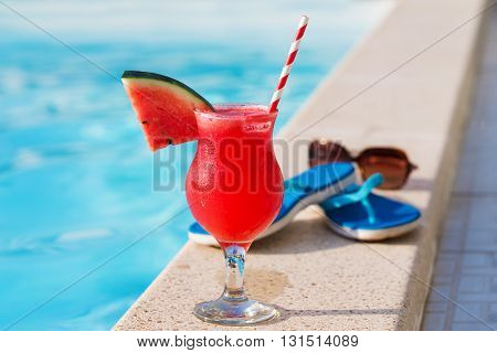 Water Melon Red Fresh Juice Smoothie Drink Cocktail Slippers And Sunglasses Near Swimming Pool