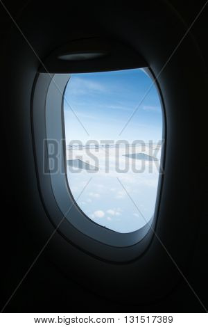 Looking through airplane window to see sky