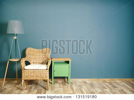 Room interior with wicker chair on dark grey wall background